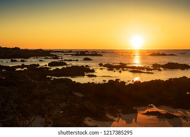Rocky coastline in San Vicente of O Grove town at golden sunset