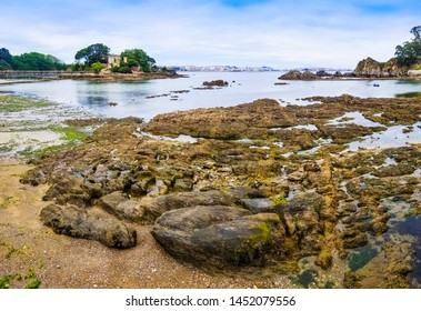Rocky coastline of Santa Cruz village in Oleiros town, Galicia, Spain