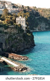 Rocky coastline in Sorrento with its wonderful villas on high cliffs overllooking the sea