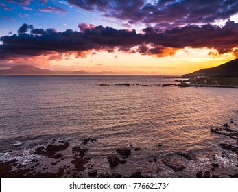 rocky coastline with splashing waves in the stragt of Gibraltar, Spain, Europe