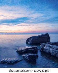 Rocky coastline sunset. Blue hour on Lake Michigan, Door County, Wisconsin