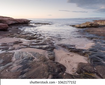 Rocky coastline at sunset near Red Bluff, Kalbarri, Western Australia