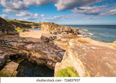 Rocky Cove and Beach at Rumbling Kern / At Rumbling Kern near Howick on the Northumberland coastline lies a small beach and cove, sheltered by small cliffs