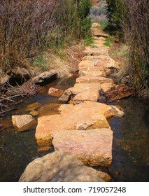 Rocky crossing over mountain stream along hiking trail.