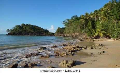 Rocky  empty beach with palms, Playa Bonita Beach, Dominican Republic, Samana peninsula