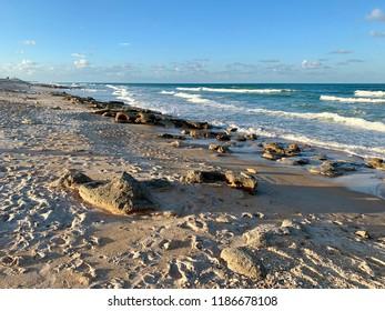Rocky Florida beach with waves.