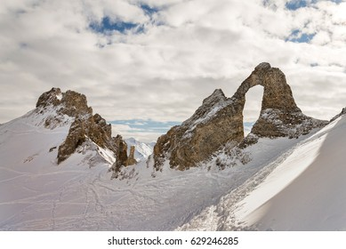 Rocky formations arch style with hole in French alps