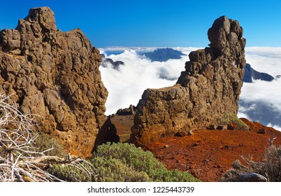 Rocky formations with clouds in Caldera de Taburiente on background, La Palma´s Island, Canary Islands, Spain