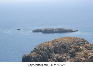 Rocky headland and islands in the sea.