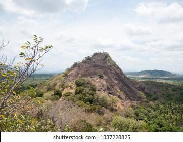 Rocky hill near Dambulla Cave temple,  Sri Lanka during drought season