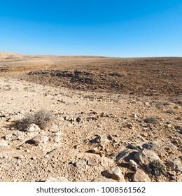 Rocky hills of the Negev Desert in Israel. Breathtaking landscape of the desert rock formations in the Southern Israel Desert.