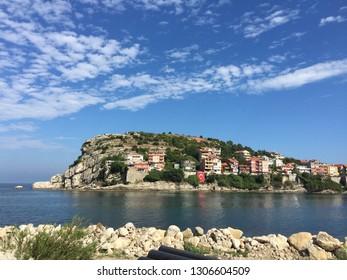 A rocky island including buildings with a blue sky on summer...(092015-Amasra, Turkey)