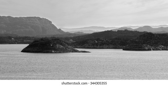 Rocky islands in Fjord Shoreline near (morning time) Bergen, Norway black and white