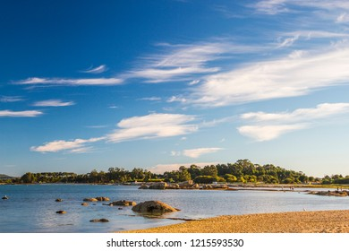 Rocky islet on Camaxe beach in Arousa Island at the evening