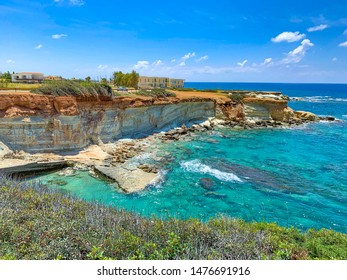 The rocky karst shore of the Mediterranean Sea. Sea caves of Paphos (Peyia)