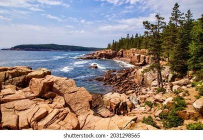 Rocky lake shore in Karelia. Forest rocky lake shore panorama. Rocky lake shore landscape