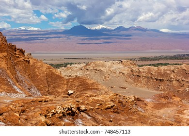 Rocky landscape of Atacama Desert, Chile, South America. Colorful rocks and mountains with snow peaks at San Pedro de Atacama.