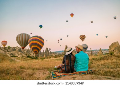 rocky landscape in Cappadocia, Turkey. Hot air ballooning in morning is most amazing attraction in Kapadokya during Sunrise, happy young couple on vacation in Goreme Cappadocia