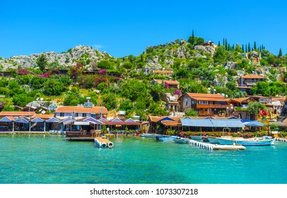Rocky landscape of Kalekoy village, the popular tourist location in Kekova bay, famous for idyllic cafes and cottages, ancient Lycian ruins, Byzantine castle and lovely beaches, Kekova, Turkey.