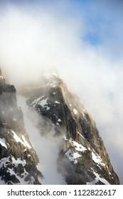 Rocky mountain in the clouds. Caucasus, Georgia
