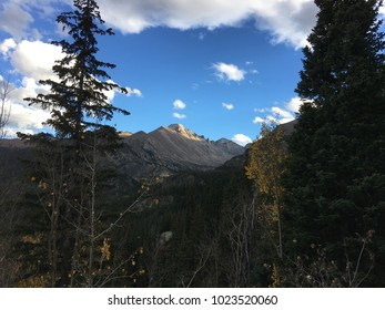 Rocky Mountain National Park during the fall season on a clear day with some clouds.