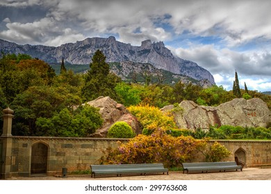 Rocky Mountain Peak with forest on hillside Ai-petri Crimea Landscape Summer day with blue sky on background
