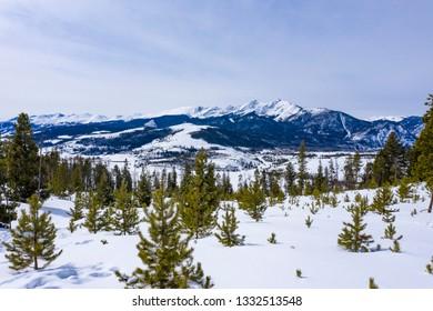 Rocky Mountain Peaks Above Frisco Colorado Winter Pine Tree Landscape
