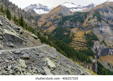 Rocky Mountain Road - A cloudy  autumn day on one-way four-wheel drive Black Bear Pass Trail at side of Ingram Peak, above Bridal Veil Falls and its historic hydroelectric power plant, near Telluride.