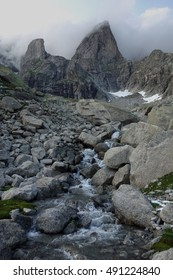 Rocky mountain and stream in Alps