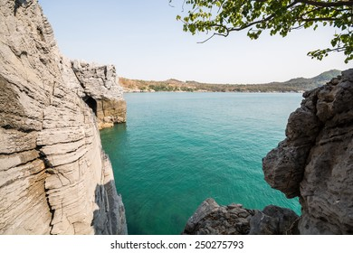 Rocky mountains and clear water at sunny day.  Cliff and the clear sea.