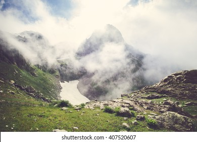 Rocky Mountains foggy Landscape with clouds and green valley Summer Travel serene scenic view