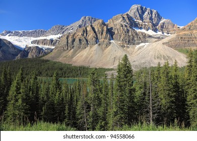 Rocky mountains, lake and wood in National park (Canada)