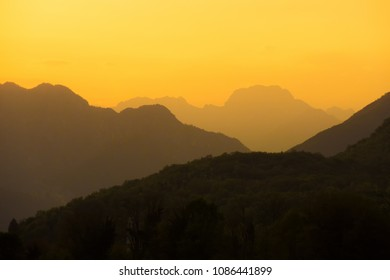 Rocky mountains silhouette on a sunset. Meduno, Italy