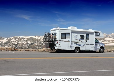 ROCKY MOUNTAINS, USA - JUNE 19, 2013: RV motorhome parked along Trail Ridge Road in Rocky Mountain National Park, Colorado. RNMP has 3,176,941 annual visitors (2011).