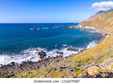 rocky ocean coast in Tenerife, panorama. The town of Taganana