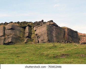 rocky outcrops boulders and stone walls in yorkshire moors