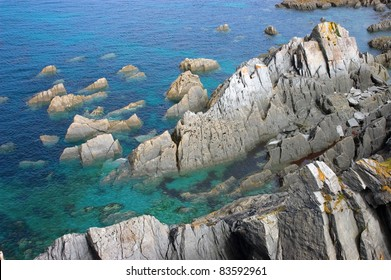 Rocky outcrops rising from a deep blue sea