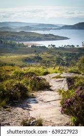 Rocky path leading down a hillside toward the shores of Loch Torridon, Scotland