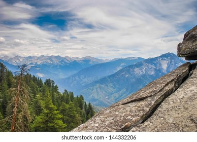 A rocky platform with a view into the distant mountains, taken in the Giant Forest of Sequoia National Park in Tulare County, California. taken in 2007