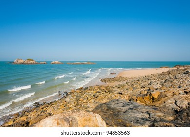 A rocky pristine beach lies beautifully untouched on Juguang Island of the Matsu Islands in Taiwan on a clear sunny, blue sky day. Horizontal copy space
