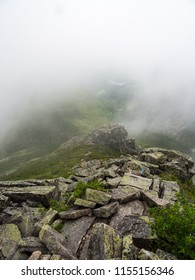 Rocky ridge under low clouds, Cathedral trail on Katahdin, Baxter State Park, Maine.