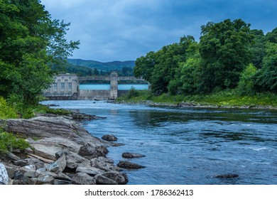 A rocky River Tummel and Pitlochry Dam at twilight on a summers evening in Pitlochry, Perthshire, Scotland