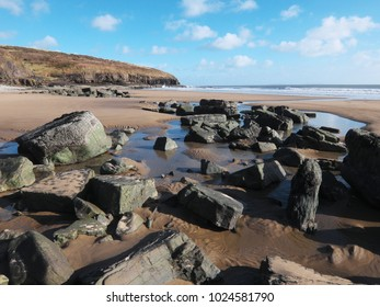 A rocky and sandy beach near Amroth, Pembrokeshire, Wales, UK.