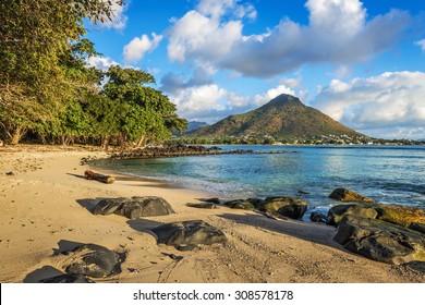 Rocky and sandy shore in Tamarin Bay, Wolmar, Flic en Flac, Mauritius Island, Indian Ocean