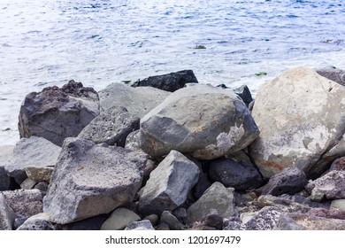 Rocky sea shore of Acitrezza next to Cyclops islands, Catania, Sicily, Italy