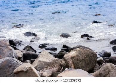 Rocky sea shore of Acitrezza next to Cyclops islands, Catania, Sicily, Italy.