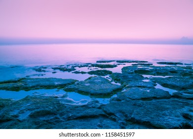 Rocky sea shore before sunrise. Early morning, wilderness, beautiful nature, serenity