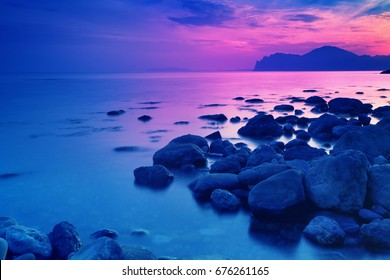 Rocky sea shore before sunrise. Early morning, wilderness, beautiful nature