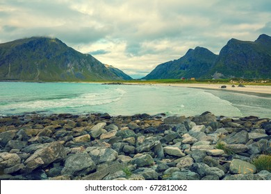 Rocky sea shore with cloudy sky. Wilderness. Beautiful nature Norway. Lofoten islands.