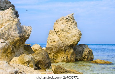 Rocky sea shore, coastline  wih blue sky and clear water